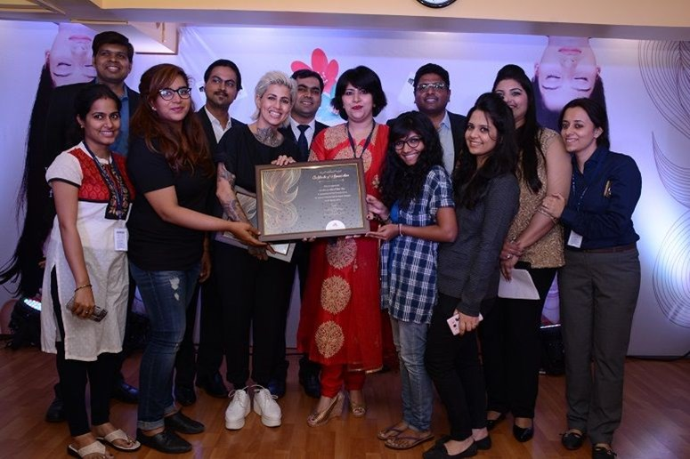 Dr. Tarang Gianchandani (CEO) & Sapna Bhavnani with entire team